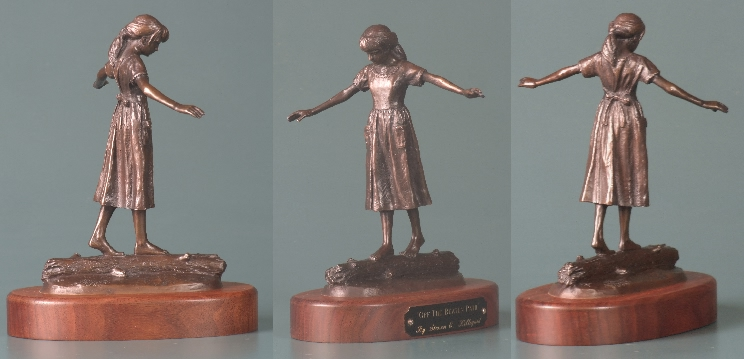 sculpture of girl walking on log
